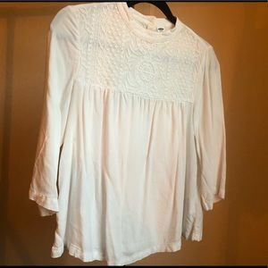 Pretty lace detail on high neck blouse
